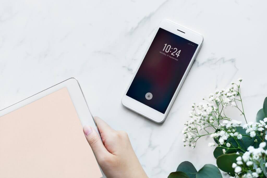 Phone on tabletop to illustrate business texting statistics