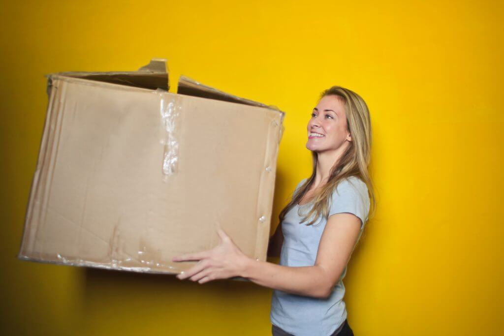 Woman holding box.
