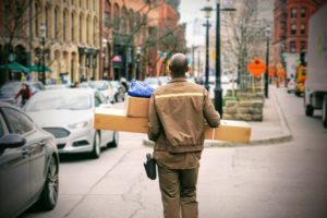 Delivery person walking to next location.