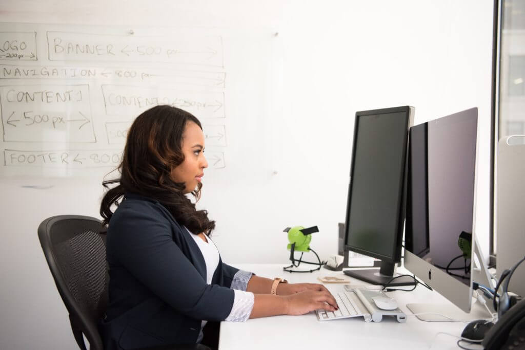 Businesswoman working at desk with computer
