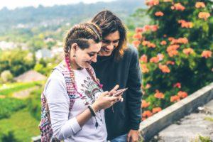 Two women checking phone.