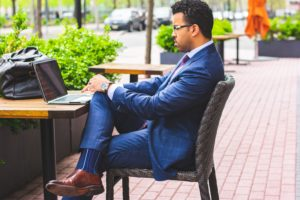 Business person with laptop at table.