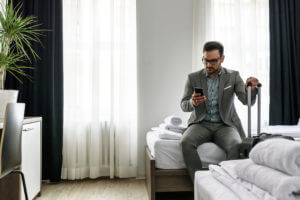 Hotel guest in room, using phone.