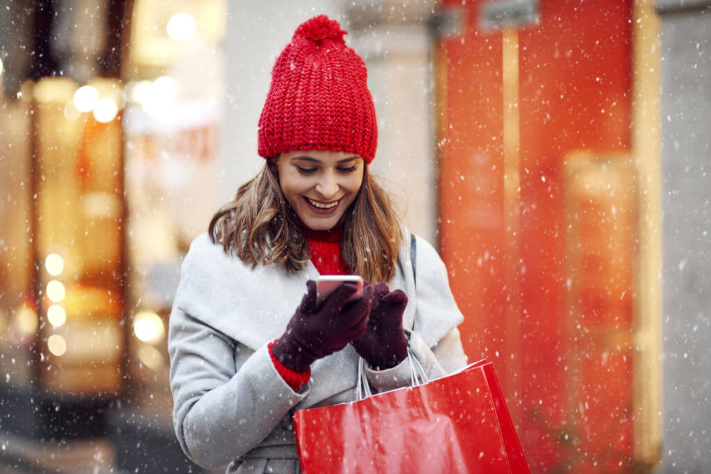 Woman and holiday sms on phone