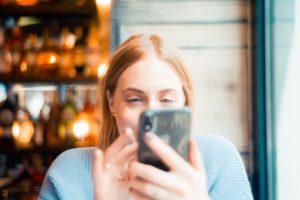 Customer texting on phone