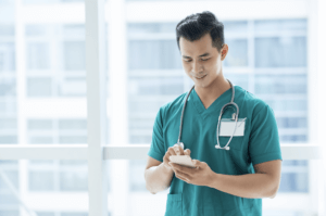 Person using SMS to scale hospital staff