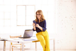 Accountant using business text messaging to communicate filing changes
