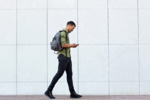 Student using college SMS on campus