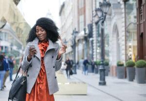 Fashionable VIP customer using her smartphone