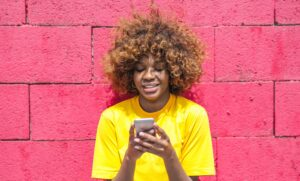 Woman happily receiving SMS customer engagement content