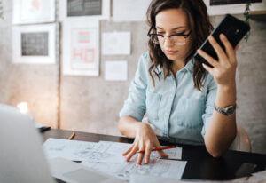 Woman strategizing technology company workflows