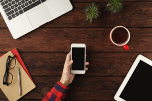 Professional choosing between email, phone calls, and business SMS