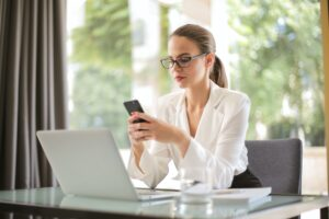 woman using a texting service for business from home