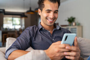 Man smiling at SMS Customer Engagement content