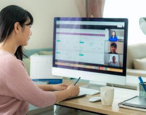 Woman attending online event