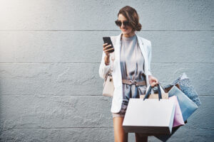 Woman using conversational customer engagement after shopping