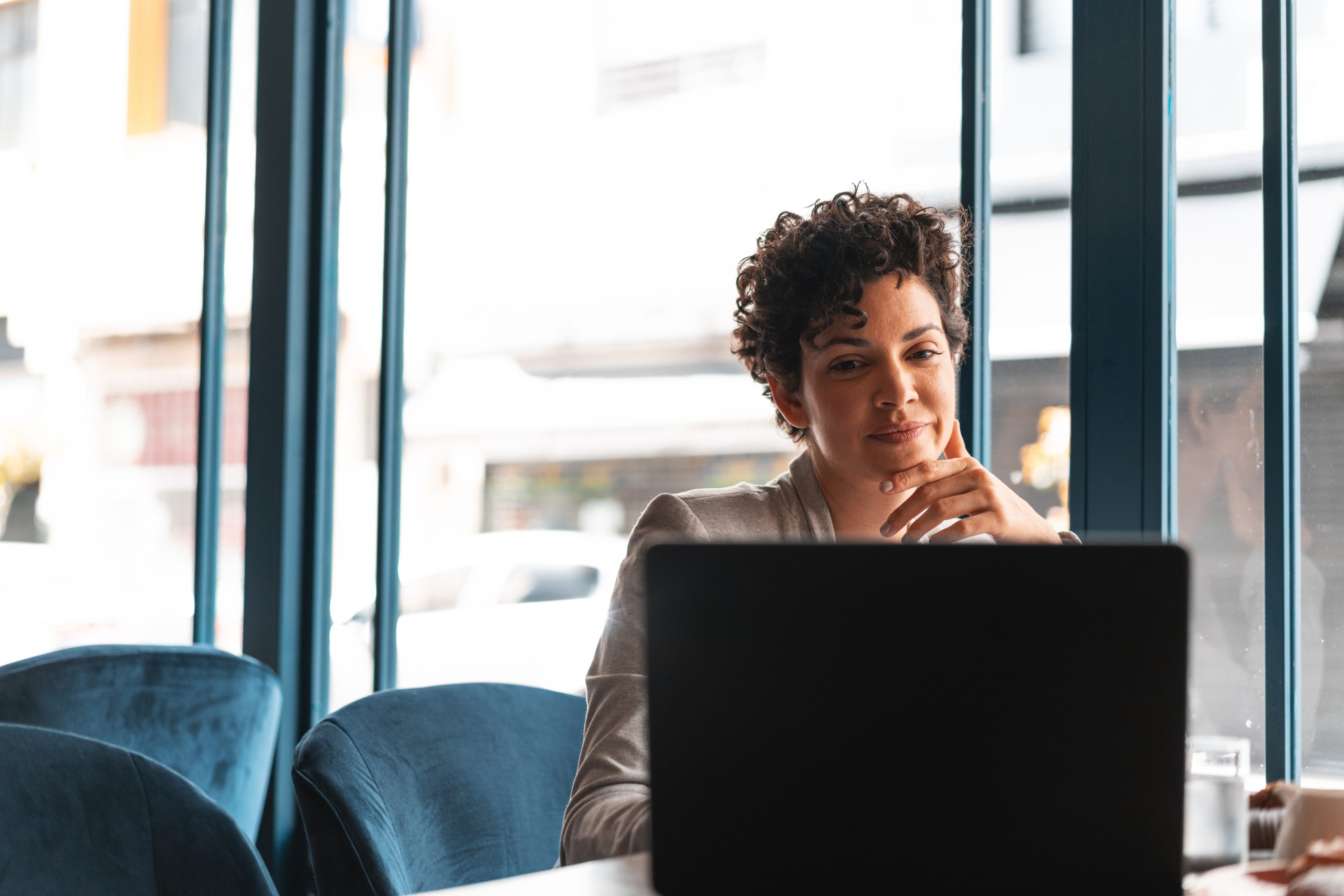 Woman at desk creating a business text messaging brand voice guide