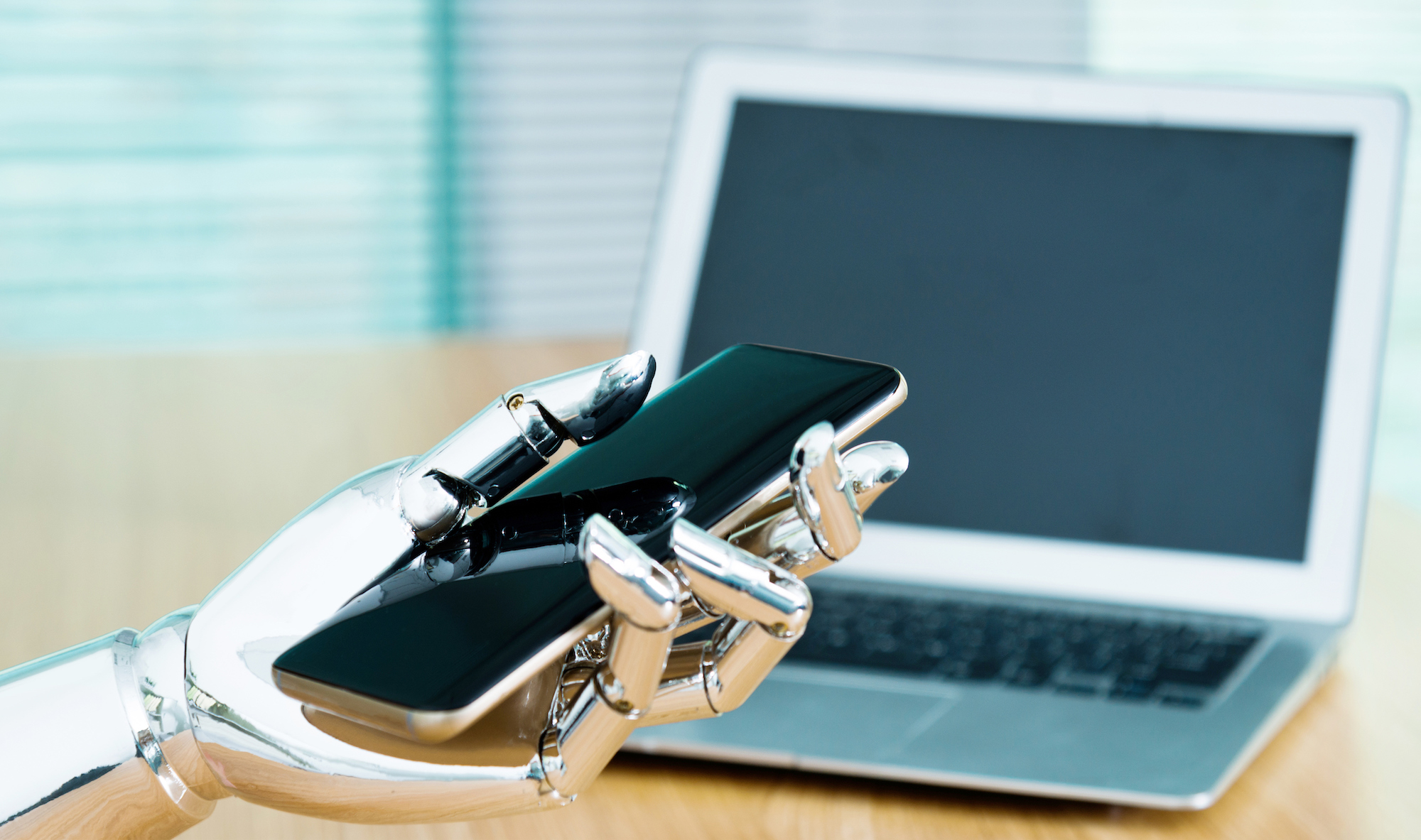 Robot hand holding a phone to indicate an SMS auto reply