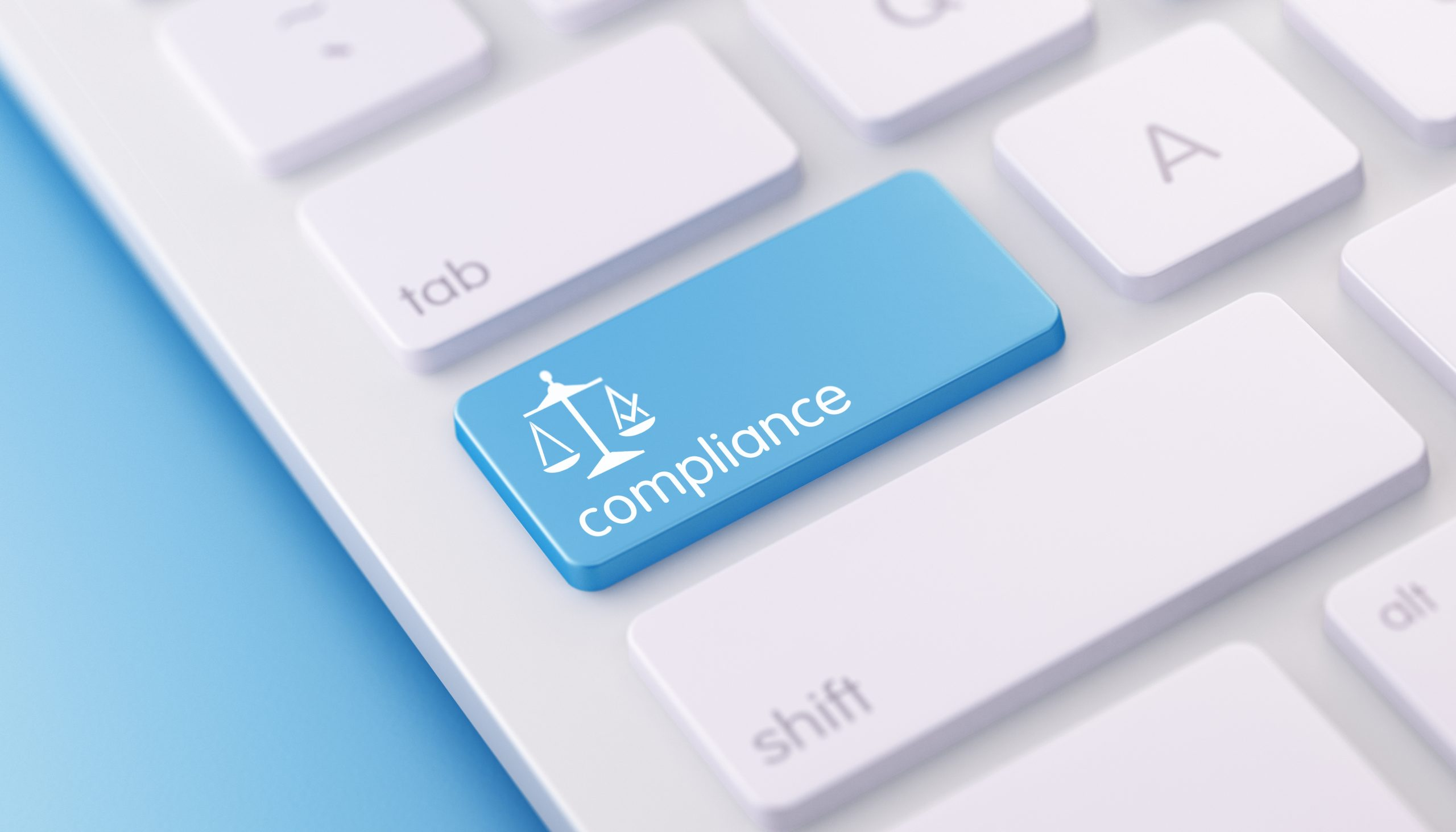 Close-up of keyboard with a Compliance button, illustrating Soc 2 compliance