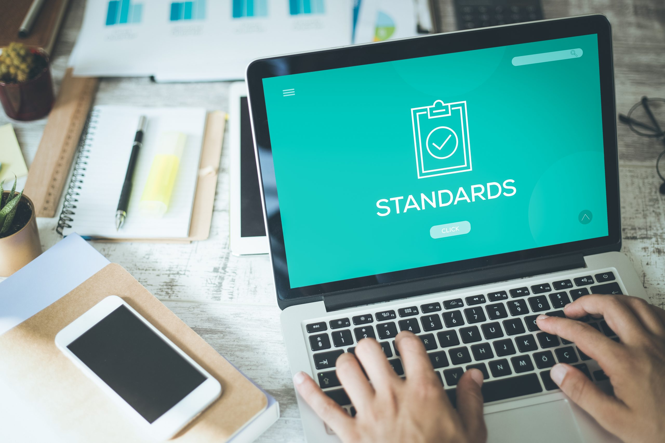 """Laptop screen with the word """"standards,"""" signifying sms compliance checklist"""