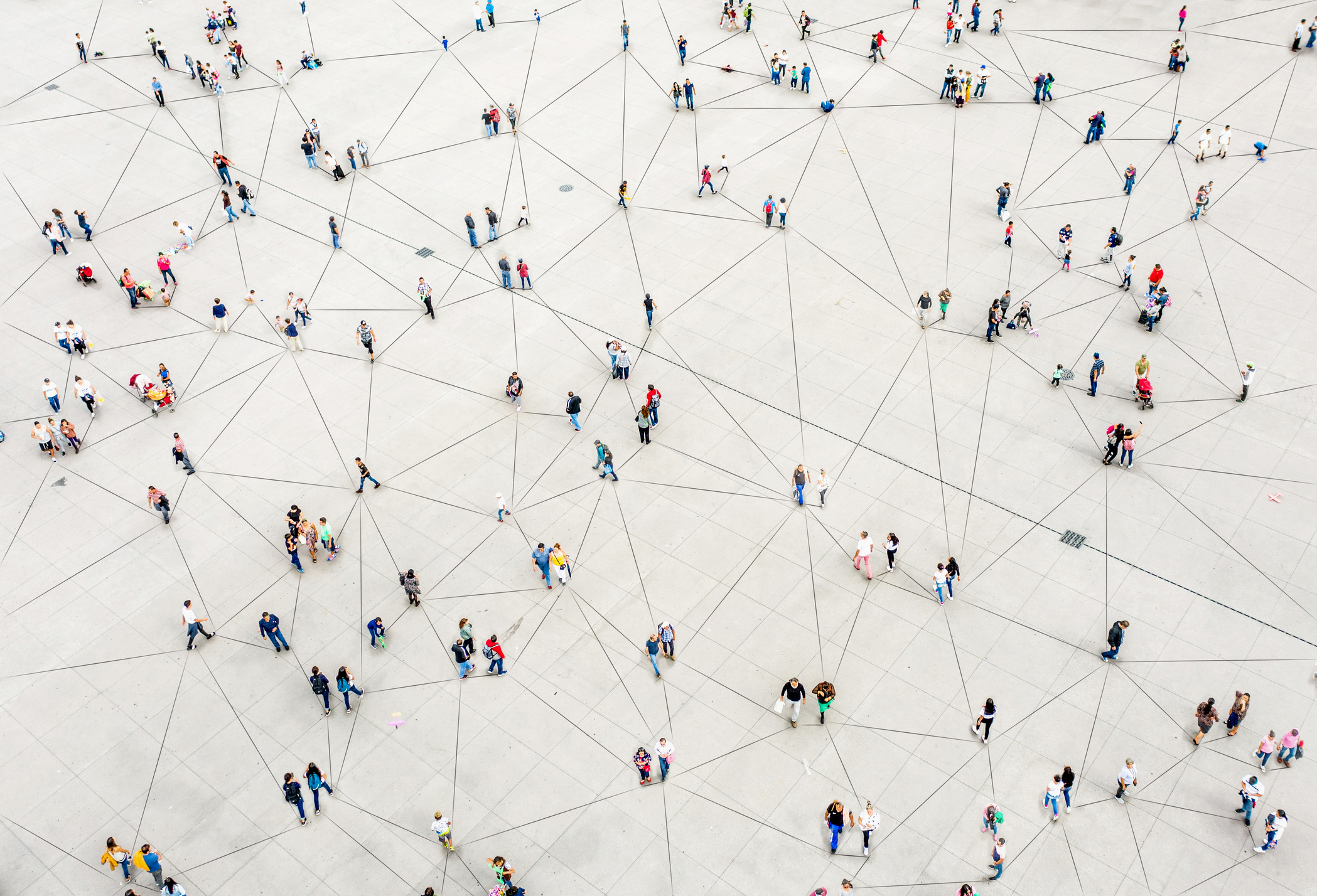 Aerial view of people connected by lines to signify the Zapier sms integration