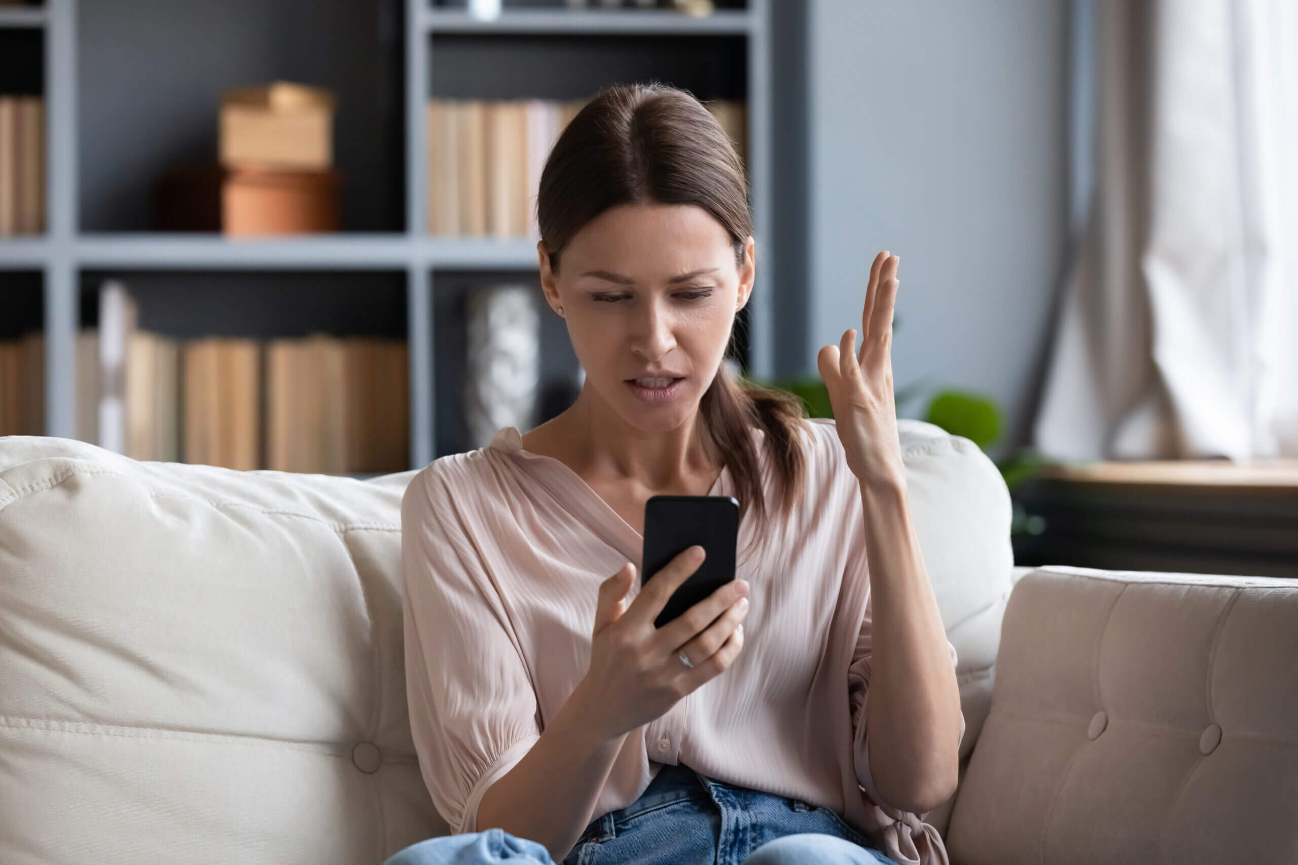 Woman recieving a text message promotion she considers spam