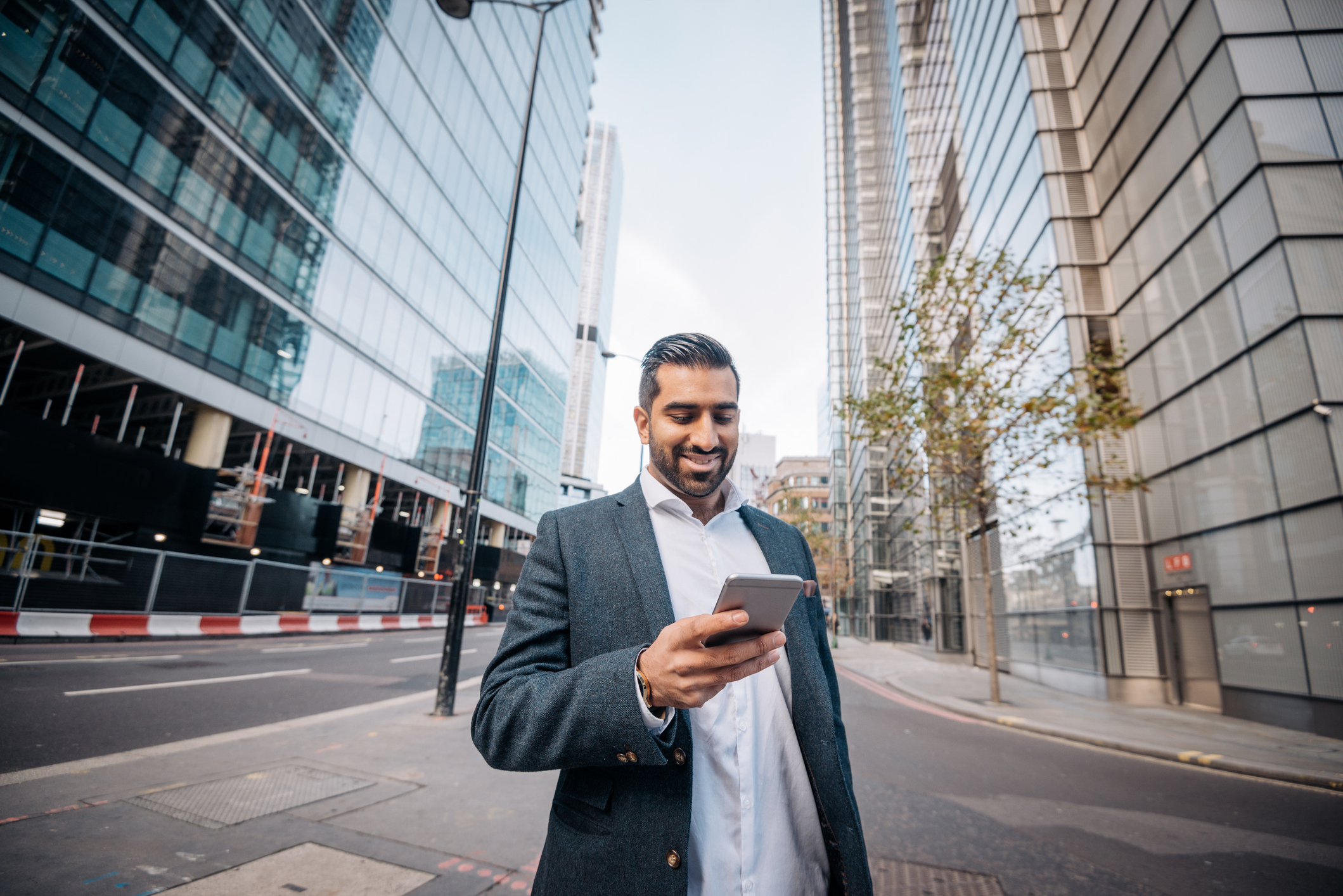 Salesman walking down street and texting with conversational sales