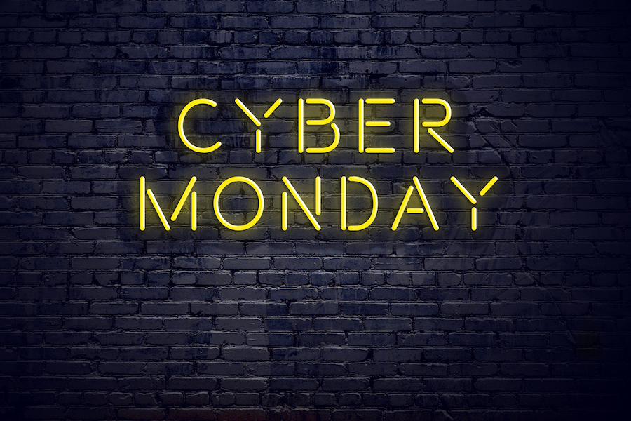 Text that reads cyber monday on a brick backdrop