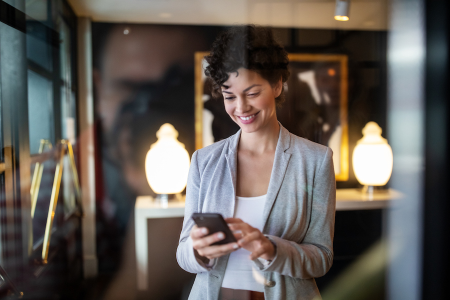 Businesswoman sending a text using a texting service for business