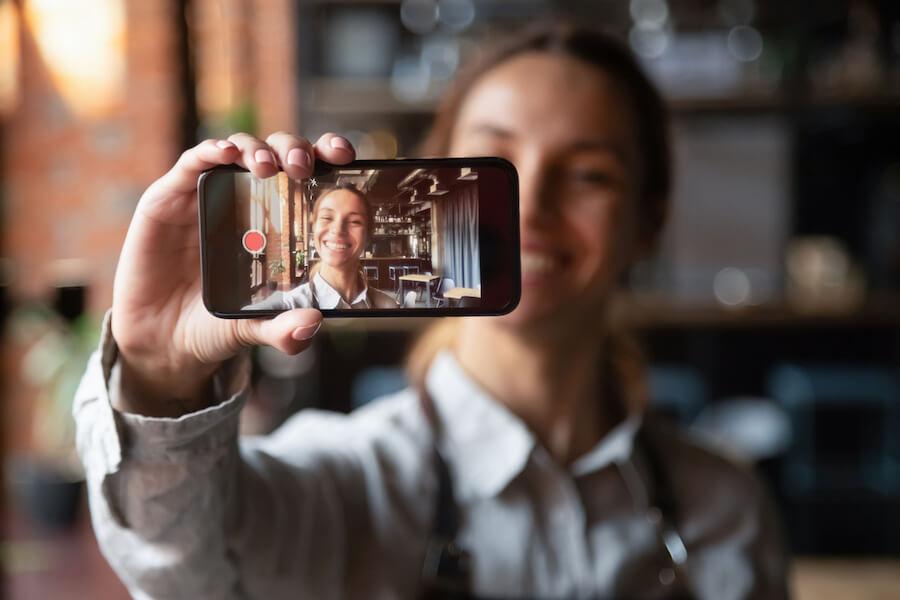 Woman filming a video selfie